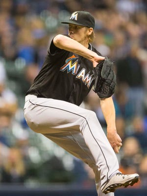 Adam Conley pitches during the seventh inning against the Brewers at Miller Park.