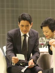 """Chow Yun-Fat (left) and Sylvia Chang (right) in """"Johnnie"""