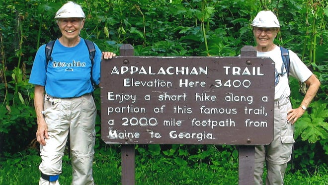 Twin sisters Sue Hollinger, left, and Elrose Couric, celebrate finishing the 2,190-mile Appalachian Trail in Virginia on July 7.