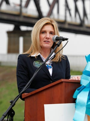 Pam Darnall, CEO of Family & Children's Place, speaks during a rally for Child Abuse Prevention Month in 2014.