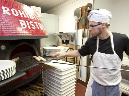 Prohibition Bistro Chef Sestim Suma bakes pizza bread