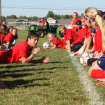 Olympic gold medalist Abby Wambach teaches teens how to do headers during Get Fit Great Falls' Elite Soccer Camp on Sunday morning.