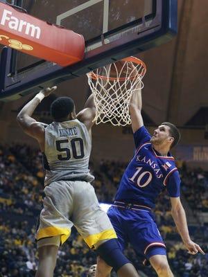 West Virginia forward Sagaba Konate (50) blocks Kansas guard Sviatoslav Mykhailiuk (10) during the first half of an NCAA college basketball game Monday, Jan. 15, 2018, in Morgantown, W.Va.