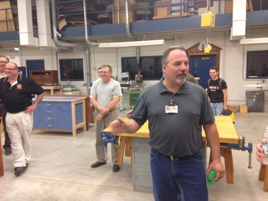 Mark Lorge addresses a crowd of wood maunfacturing