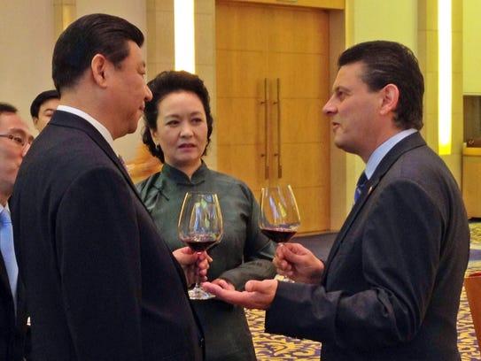 Luca Berrone of Iowa, right, chats with Xi Jinping,