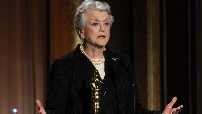 Angela Lansbury accepts honorary Oscar during the Academy of Motion Picture Arts and Sciences' Governors Awards Center on Nov. 16, 2013 in Hollywood.