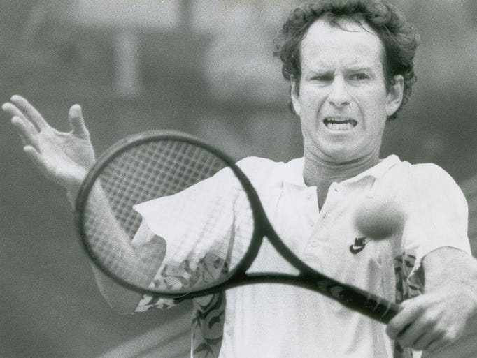 A serious John McEnroe wasted little time in ousting local favorite Todd Witsken, 6-1-6-0 in Indianapolis, August 1989.