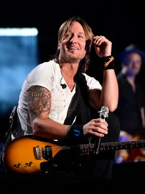 Keith Urban performs at Nissan Stadium on the final day of CMA Fest 2017, on Sunday, June 11, 2017, in Nashville, Tenn.