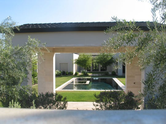 7804 Investment LLC of Scottsdale paid $6.45 million in cash for this 11,697 square-foot home on more than two and a half acres on Mummy Mountain Park in Paradise Valley. The sale closed during the week of April 13, 2015.