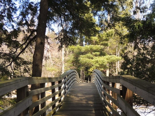 At Goodman County Park, northwest of Crivitz in Marinette County, visitors can criss-cross Strong Falls over boardwalks and bridges as the river channel splits and rushes by below.