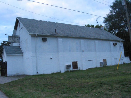 Motor City Youth Theatre's playhouse has a steep roof in need of replacement. This is how the building looked 10 years ago, a year after the troupe moved in.