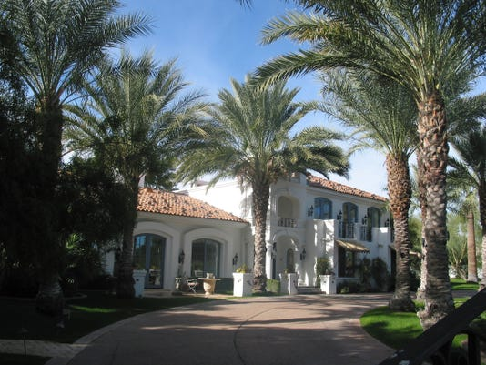 John and Jennifer Vargas paid $3.65 million for this 8,312 square-foot home on more than two acres at Camelback Lands in Paradise Valley. The sale closed during the week of Dec. 15, 2014.