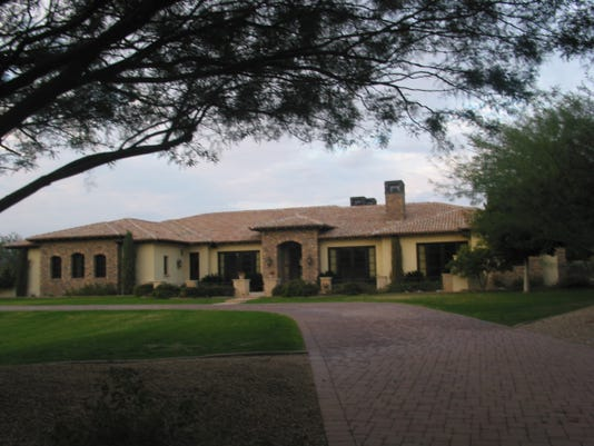 Michael and Stacy Lovell paid $2.4 million for this 6,521 square-foot home on nearly two acres south of Camelback Mountain in Phoenix. The sale closed during the week of Dec. 22, 2014.