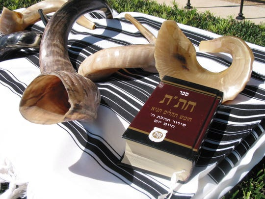 An antelopes horn is pictured on the left along with other Shofars. The Chitat is read during the Rosh Hashana services.