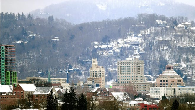 Snow covers the homes on Town Mountain in Asheville January 17, 2018.