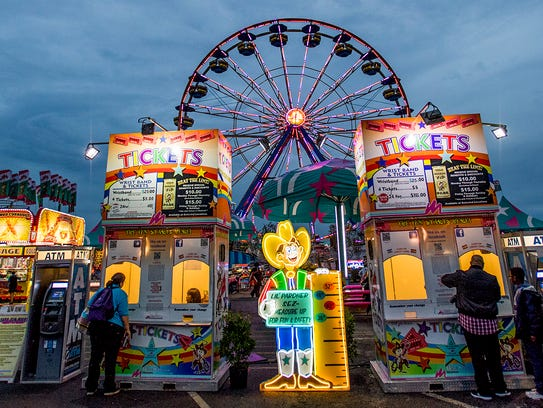 Fair goers enjoy the Alabama National Fair in Montgomery,
