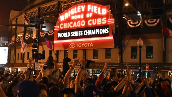 Nov 2, 2016; Chicago, IL, USA;  Chicago Cubs fans celebrate after game seven of the 2016 World Series against the Cleveland Indians outside of Wrigley Field. Cubs won 8-7.