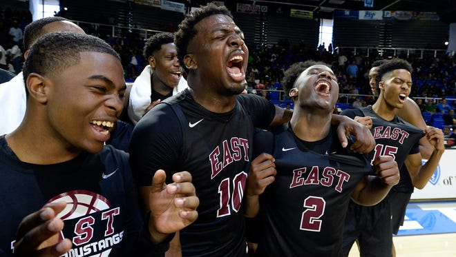 East forward Radarious Washington (10), Alex Lomax (2) and Jayden Hardaway (15) celebrate after their win over Southwind in the Division I AAA boys high school basketball championship game March 18, 2017.