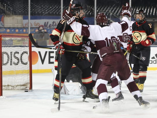 Don Bosco celebrates goal scored by Robby Greenleaf in the first period.