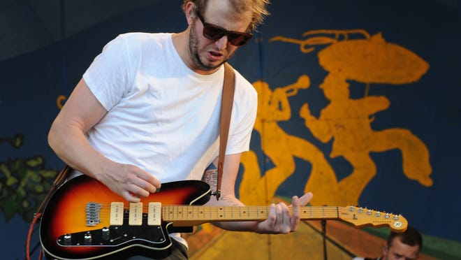 ORG XMIT: HB 41767 jazzfest 4/27/2012  4/27/12 6:38:43 PM -- New Orleans, LA, U.S.A -- New Orleans Jazz and Heritage Festival -- Justin Vernon plays a riff during Bon Iver's performance on the Gentilly Stage.   Photo by H. Darr Beiser, USA TODAY Staff  [Via MerlinFTP Drop]