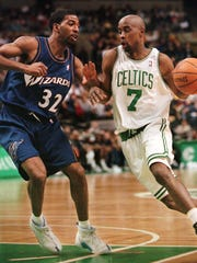 The Boston Celtics' Kenny Anderson, right, drives toward the net past the Washington Wizards' Richard Hamilton during a game on March 31, 2000. Anderson is now the men's basketball coach at Fisk University in Nashville.