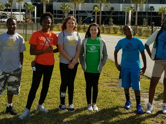 Teen Club members from the Stuart Club at the Daytona International Speedway on a field trip learning about velocity, speed and laws of physics