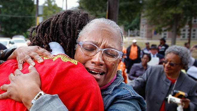 Octopber 3, 2015 - Rosalyn Willis hugs her brother Menelik Fombi who was one of the 13 first-graders who desegregated the Memphis City Schools in 1961. Fombi and many of the Memphis 13 were on hand during a ceremony unveiling historical markers outside of the schools they attended starting with the marker shown here outside of Bellevue Middle School which was Bruce Elementary at the time. (Jim Weber/The Commercial Appeal)