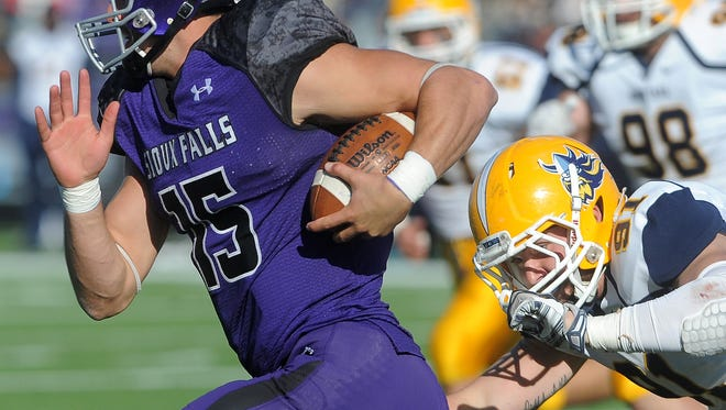 University of Sioux Falls' Luke Papilion runs away from Augustana University's Zach Richter during their game at Bob Young Field on Saturday, Oct. 24, 2015.