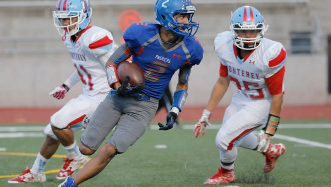Americas' Nathan Carrazco takes the kickoff back for a touchdown last week against Lubbock Monterey. Americas plays San Angelo Central on Friday in Midland.