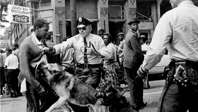 A police dog attacks a youth during a 1963 protest in Birmingham Ala., in this Associated Press photo taken by Bill Hudson.