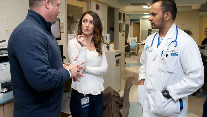 John Brogan (left) and Angela Cicchino, both Toms River are Recovery Specialists in Barnabas Health's new Opioid Overdose Program. The program uses ex addicts to get drug abusers into treatment. They talk with Dr. Vikram Varma, Community Med Ctr Chairman of Emergency Services (right) in the hospital's ER—February 26, 2016-Toms River NJ.-Staff photographer/Bob Bielk/Asbury Park Press