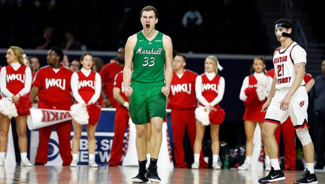 Marshall Thundering Herd guard Jon Elmore (33) reacts to a basket during the second half against the Western Kentucky Hilltoppers during the Conference USA title game.
