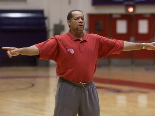 Detroit Mercy basketball coach Perry Watson directs