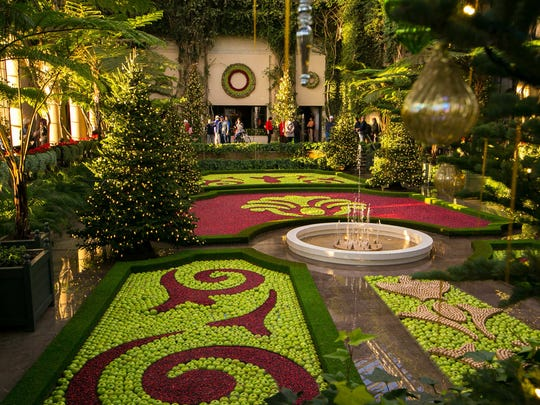 A floating tapestry of cranberries, apples and gilded walnuts highlights the French theme of the 2017 Longwood Gardens Christmas display.