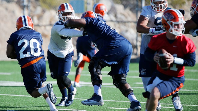 Outside linebacker Lawrence Montegut (33 in white) goes through practice at his new position during the second day of spring football pracitce for the UTEP Miners. With a new defense installed under a new coaching staff Montegut says he likes the new scheme because it gives a bigger challenge and the ability to showcase his talents.