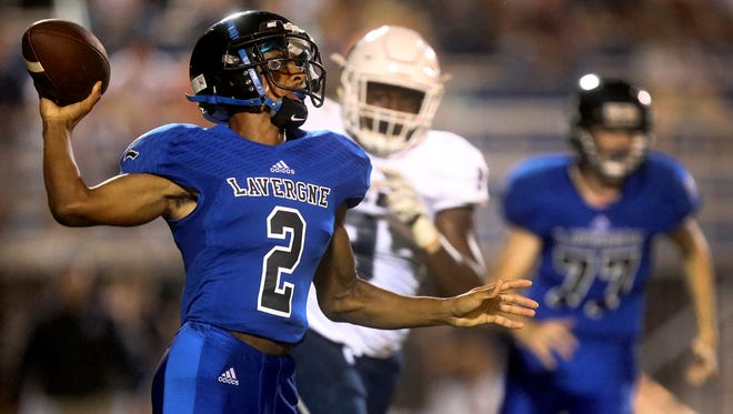 La Vergne's Keianthony Conner (2) drops back to pass the ball during the Jamboree game against Siegel on Friday, Aug. 11, 2017.