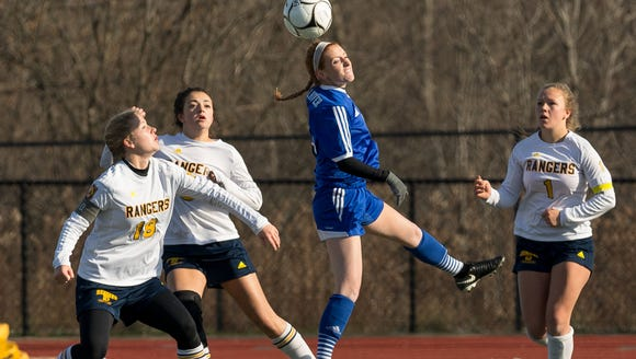 Pearl River's Tara Guilfoyle, center, plays the ball