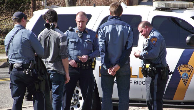Ridgewood Police took four people into custody Tuesday in front of Temple Israel, 475 Grove St., Ridgewood.