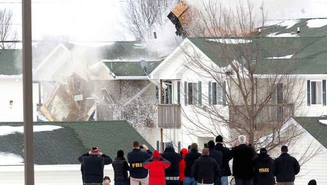 Federal and local law enforcement personnel watch as explosives found in an apartment building in Beaver Dam are detonated Wednesday March 7, 2018. The explosives were found after a previous explosion killed the apartment's tenant Monday.