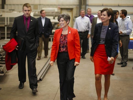 U.S. Sen. Joni Ernst (R-Iowa) toured the KemX Global building, which is still being constructed, with Iowa Lt. Gov. Kim Reynolds, right, on Friday, May 20, 2016, in Boone.
