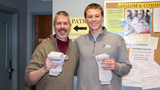 Keaton Hendricks with Forrest Gilmore, executive director of the Shalom Center.