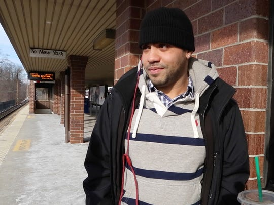Ezar Merengueli, 31, waits for a train at the White