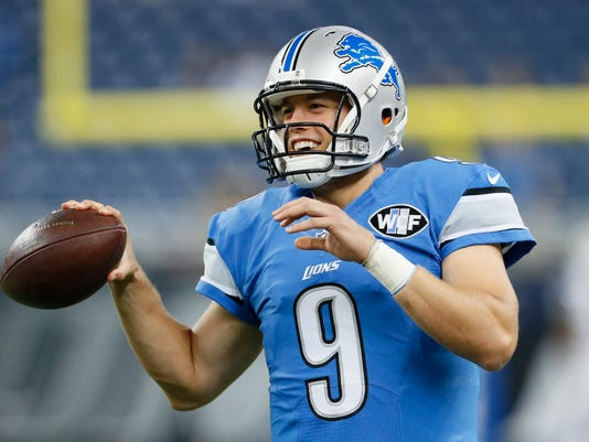 635751612142592113-AP-Jets-Lions-Football-DTF10