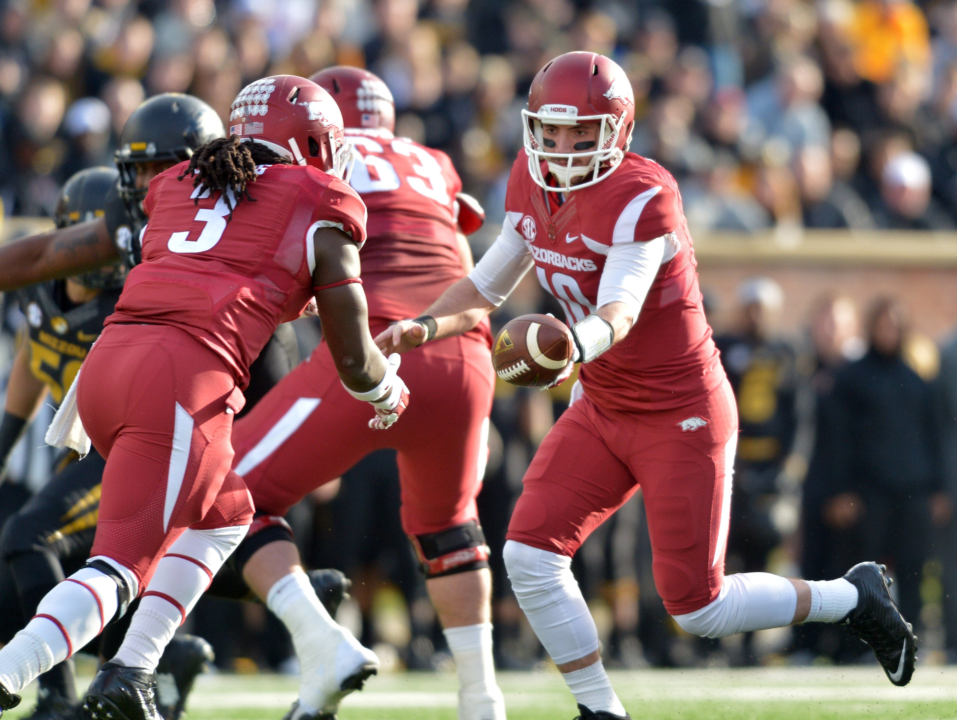 Arkansas quarterback Brandon Allen (10) hands off to running back Alex Collins (3) during the first half against Missouri at Faurot Field. Collins rushed 10 times for 70 yards in a scrimmage on Saturday.