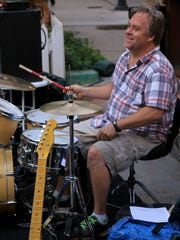 Gordon Strang plays drums for multiple local bands in addition to promoting shows and organizing events.