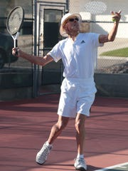 Norm King serves to friend Vic Adams during one of their regular tennis matches, February 22, 2018.  The two have been playing tennis together regularly in Palm Springs for the past 29 years.
