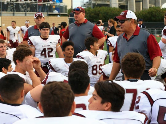 GABE HERNANDEZ/CALLER-TIMESCalallen head coach Phil Danaher talks to his players after defeating Boerne during the regional semifinals Friday, Nov. 26, 2016, at Farris Stadium in San Antonio.