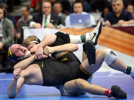 Iowa's Alex Marinelli wrestles Wisconsin's Evan Wick at 165 pounds at the NCAA Wrestling Championships at Quicken Loans Arena in Cleveland, Ohio on Saturday, March 17, 2018. Marinelli lost by major decision, 16-3.