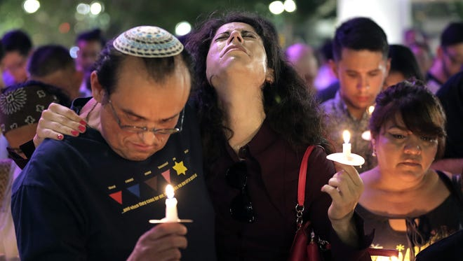 Hundreds of El Pasoans gathered Sunday at San Jacinto Plaza for a candlelight vigil to honor the victims of the mass killing in Orlando overnight. Fifty people were killed at 2am Sunday morning at Pulse nightclub in Orlando.