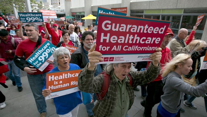 Supporters of single-payer health care march to the Capitol on April 26, 2017, in Sacramento after the California Senate approved  SB 562 that would guarantee health coverage with no out-of-pocket cost for all California residents, including people living in the country illegally.